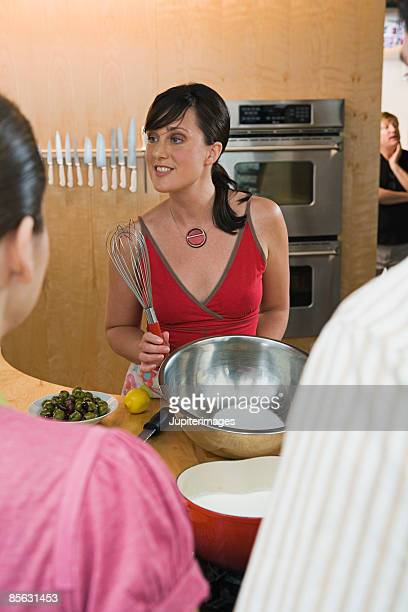 Woman with whisk teaching class