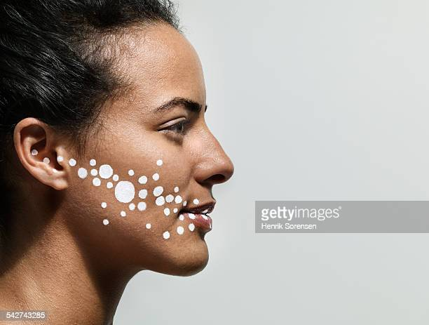Woman with white dots on her face