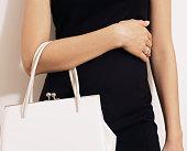 Woman with white handbag