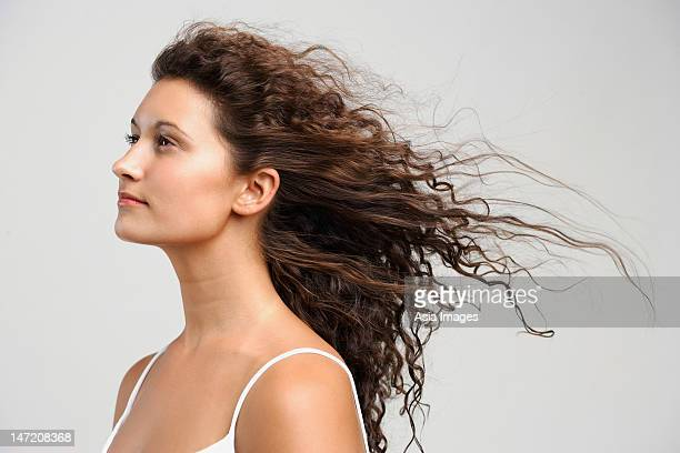 woman with wind blowing in face, eyes open