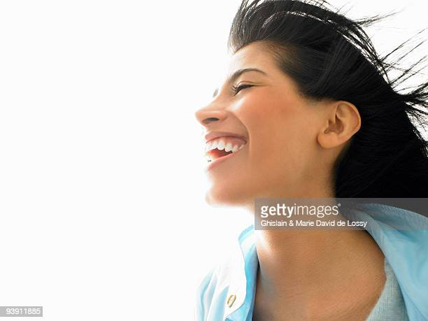 Woman with wind in her hair, smiling