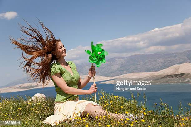Woman with wind wheel by sea
