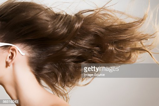 Woman with windswept hair : Stock Photo