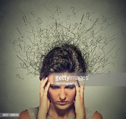 Woman with worried stressed face expression brain melting into lines : Stock Photo