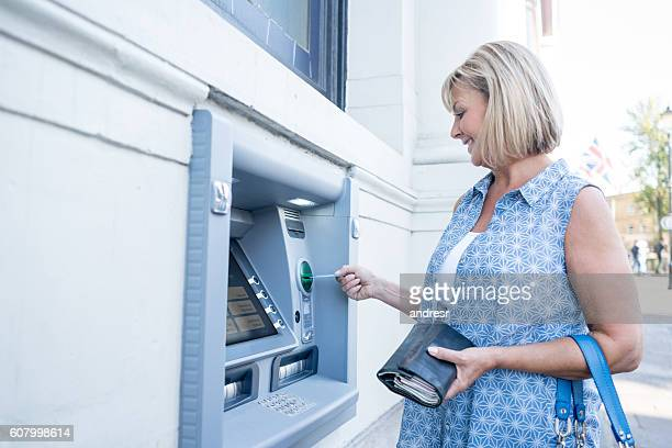 Woman withdrawing cash from an ATM