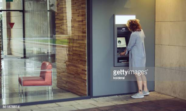 Woman withdrawing cash from ATM