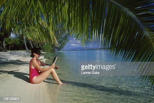 Woman w/laptop computer in Bora Bora : Stock Photo