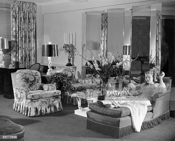 Woman w/magazine relaxing in living room