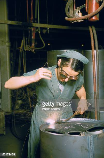 A woman working as a welder in Britain during World War II circa 1943