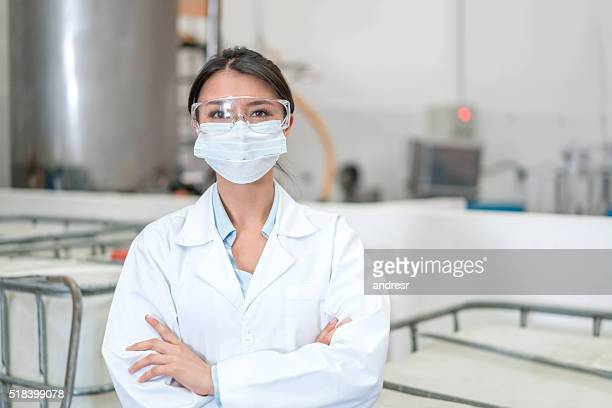 Woman working at a chemical factory