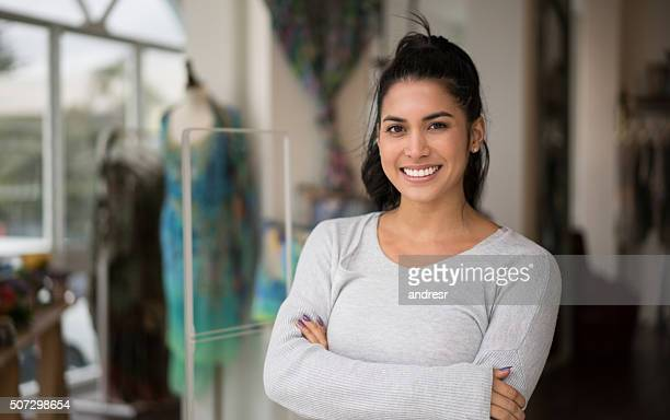 Woman working at a clothing shop