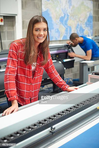 woman working at a digital printers