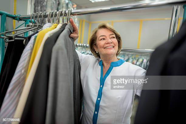 Woman working at a laundry service shop