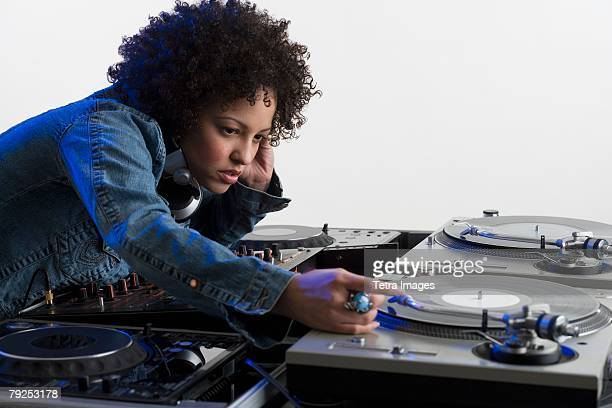 Woman working at a mixing board