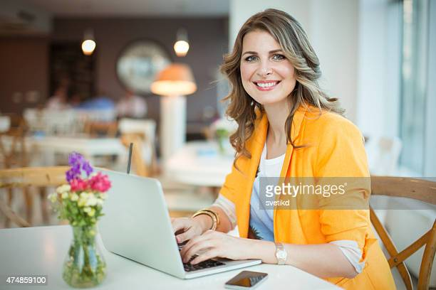 Woman working at cafe.
