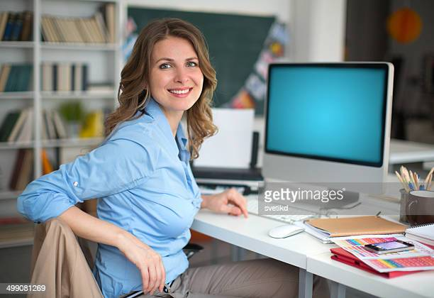 Woman working at computer.