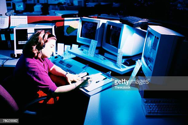 Woman working at dispatch terminal