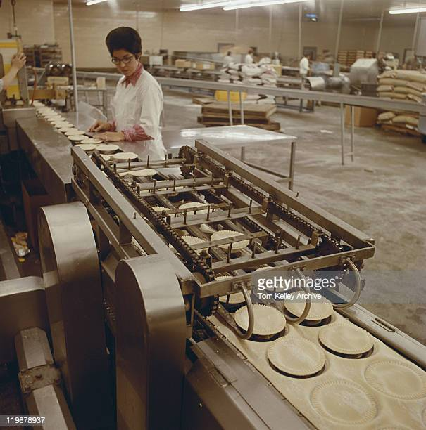 Woman working at food processing plant
