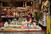 Woman working at natural soaps stall at Fremantle Markets.