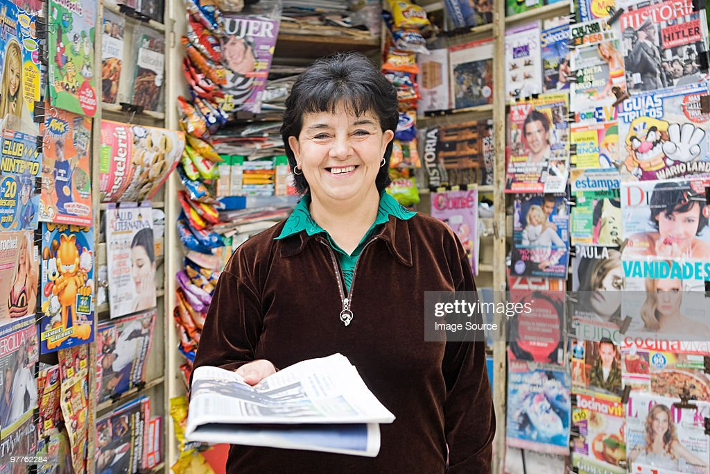 Woman working at newsstand