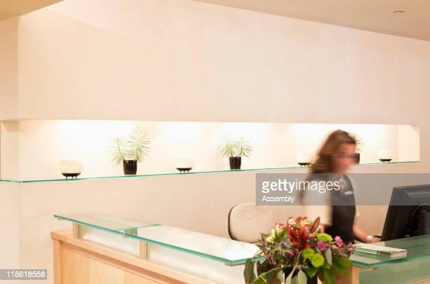 Woman working at spa resort desk