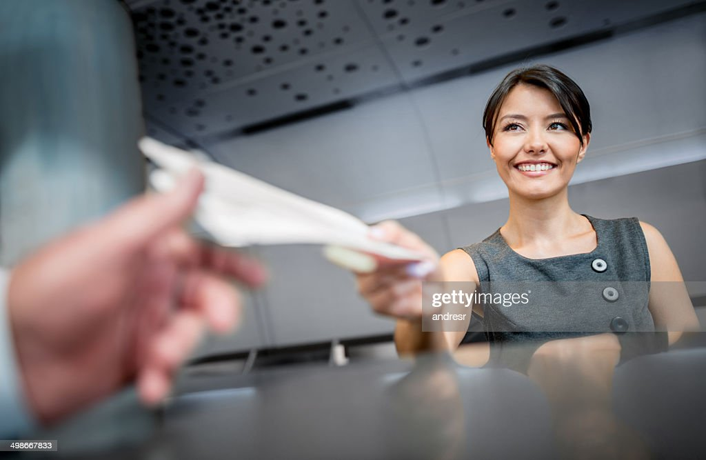 Woman working at the airport : Stock Photo