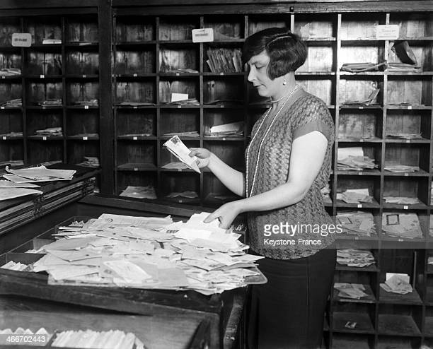 Woman working at the dead letters office circa 1920