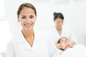 Portrait of a Latin woman working at the spa looking friendly and smiling