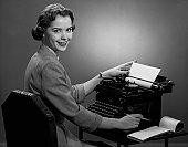 Woman working at typewriter