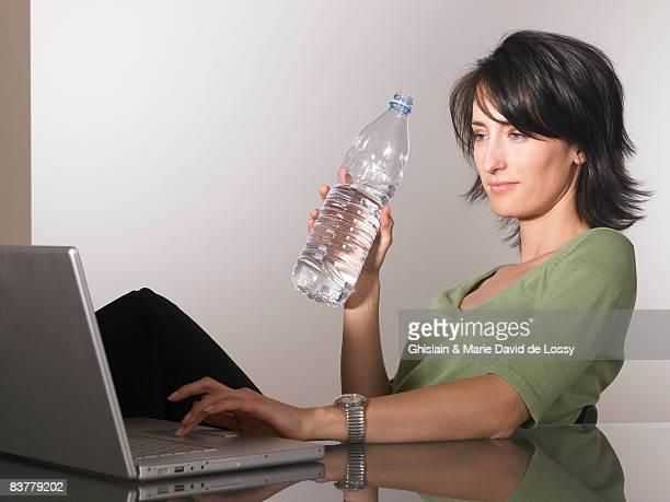 Woman working, drinking water