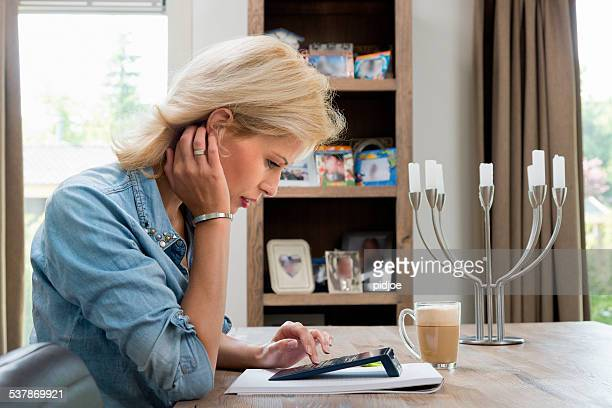 Woman working finance at home