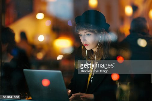 Woman Working from Cafe