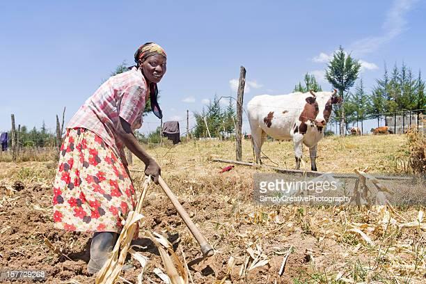 Woman Working Garden in Africa