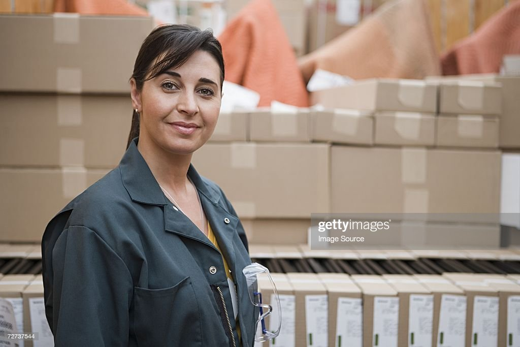 Woman working in a distribution warehouse : Stock Photo