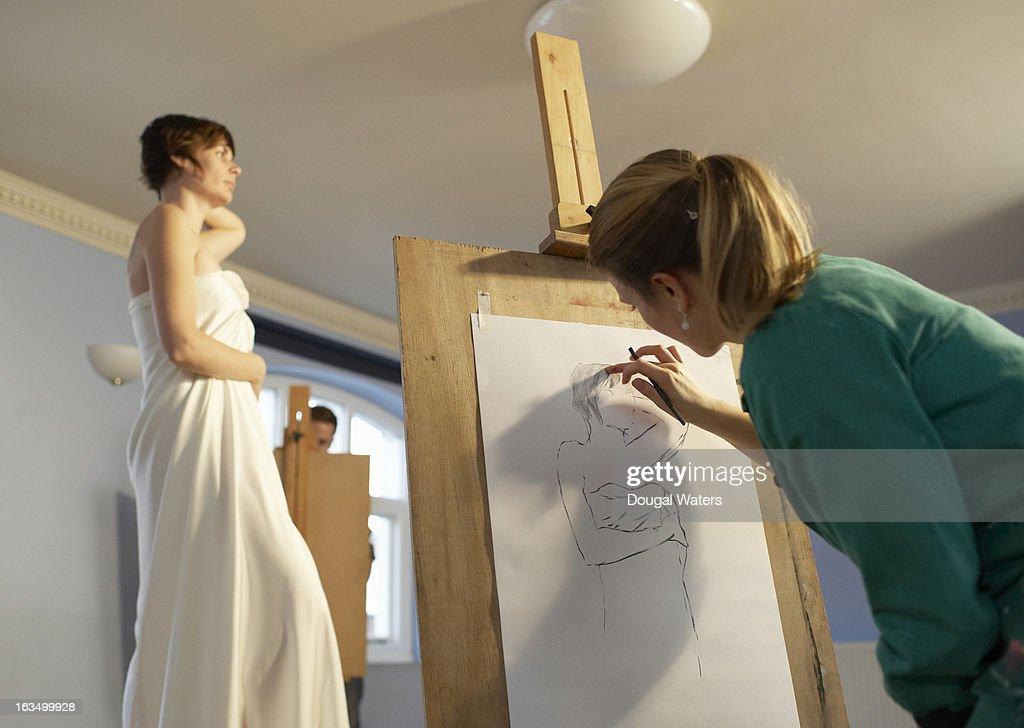 Woman working in an art class.