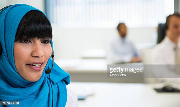 Woman working in call centre office
