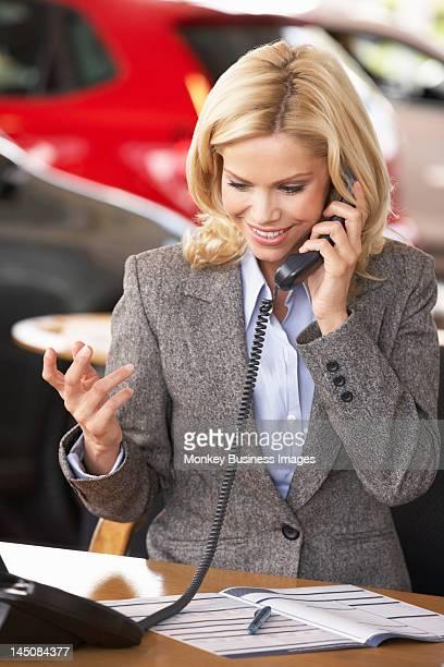 Woman working in car showroom