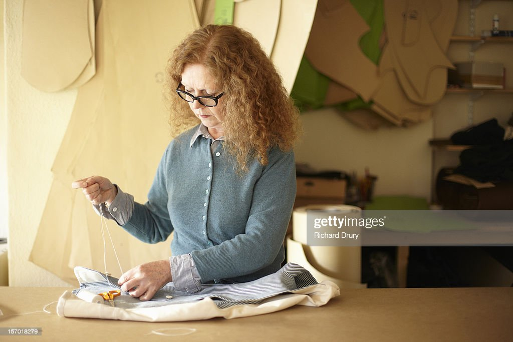 Woman working in clothing manufacturer's workshop : Stock Photo
