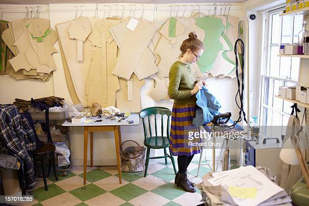 woman working in clothing manufacturer's workshop