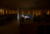 Woman Working in Dark Office