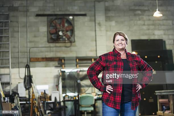 Woman working in factory warehouse