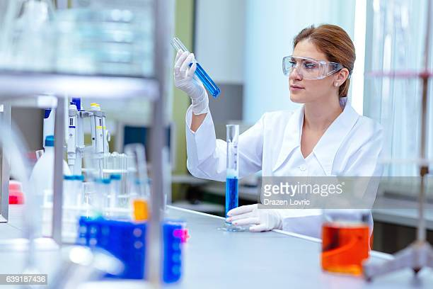 Woman working in laboratory on experiment with chemicals