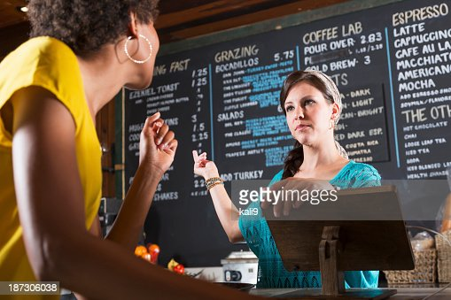 Woman working in restaurant taking customer order