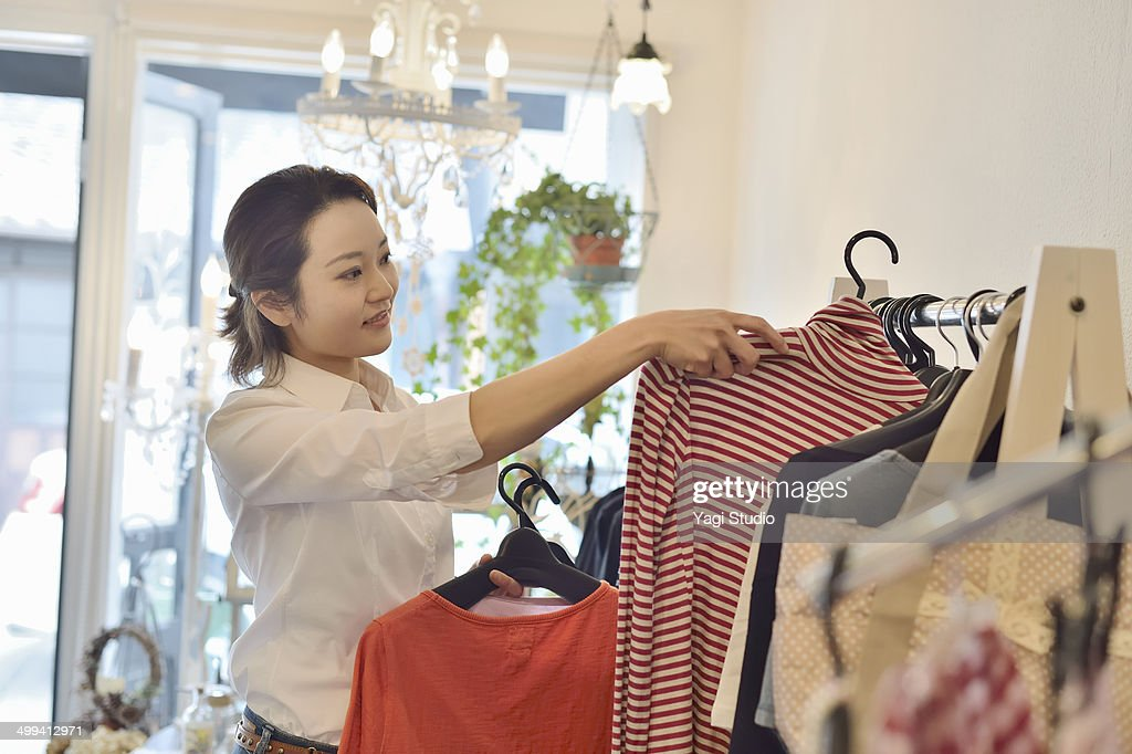 woman working in store : Stock Photo