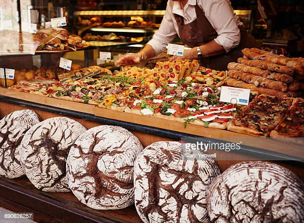 Woman working in traditional Italian food shop