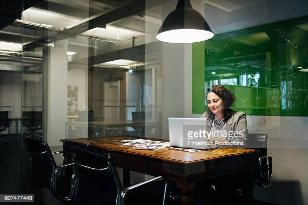 Woman working late in a modern office.
