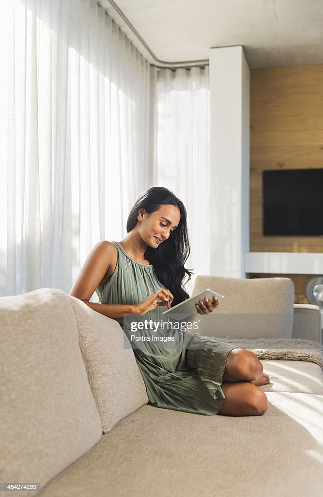 Woman working on a digital tablet. : Stock Photo