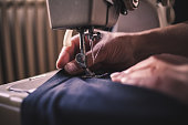 Close up of Woman Working on a Sewing Machine