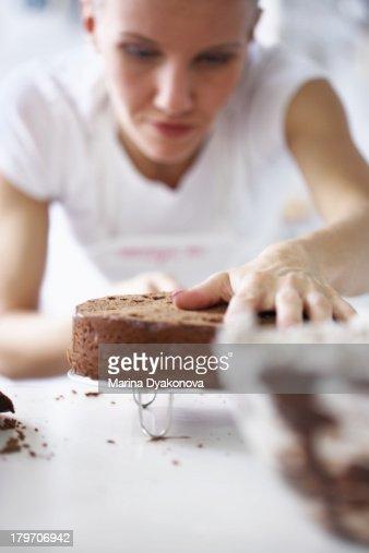 Woman working on cake