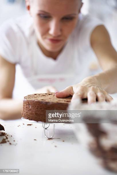 Woman working on cake